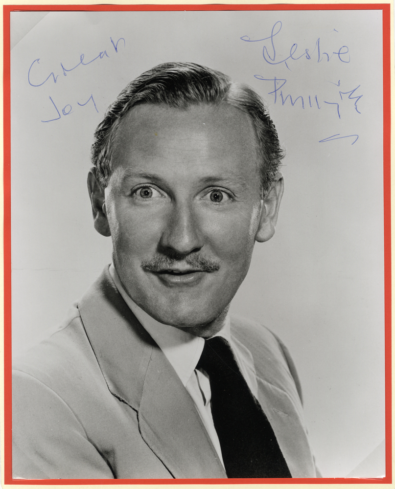 PHILLIPS, LESLIE (English actor) black & white photograph signed 'Leslie Phillips'