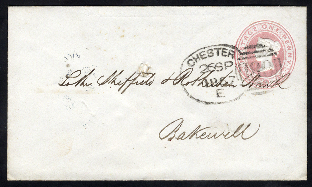 1857 One Penny pink postal stationery envelope to Bakewell, cancelled by a 'Chester 180' spoon
