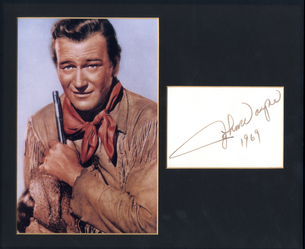 WAYNE, JOHN 1907-1999 (American Actor & Academy Award Winner) signed album page with coloured picture