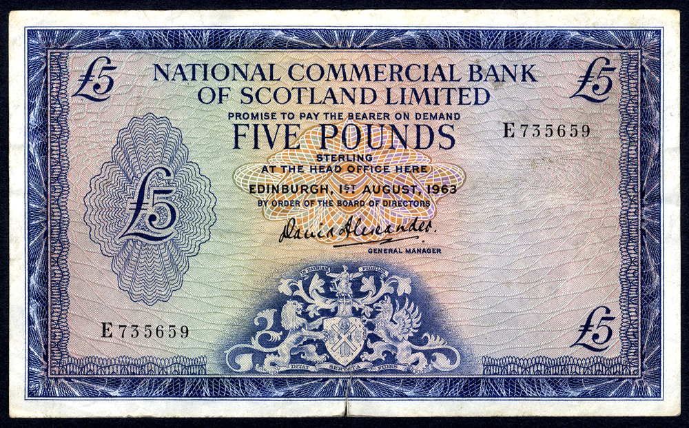 National Commercial Bank of Scotland 1963 Aug £5 blue on multi-colour 'Alexander' (E735659), small tear at base o/w VF.